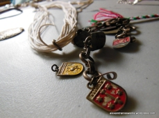 Now you will need circle findings. I recommend charm bracelets